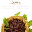 Coffee beans in a wicker basket decorated with green leaves isolated on white background — Stock Photo