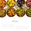 Different varieties of olives marinated in traditional clay bowls decorated with branches of olive tree isolated on white background — Stock Photo