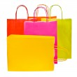 Brightly colored paper shopping bags isolated on white background — Stock Photo #30084655