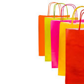 Brightly colored paper shopping bags isolated on white background — Stock Photo