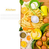 Topic cooking - the board and the dough, fresh pasta, eggs, cutlery still life in general with sample text isolated on white background — Stock Photo