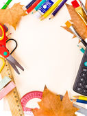 Back to school concept , Photo of Items for school student gear over cardboard background and autumn maple leaves — Stock Photo