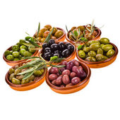 Different varieties of olives marinated in traditional clay bowls — Stock Photo