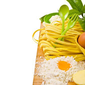 Topic cooking - the board and the dough, fresh pasta, eggs, cutlery still life — Stock Photo