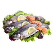 Fresh trout lying on the leaves of lettuce — Stock Photo