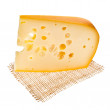 图库照片: Emmental cheese piece