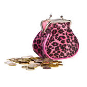 Glamor purse and scattered small coins — Stock Photo