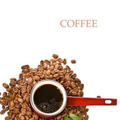 Old red coffee maker and roasted coffee beans — Stock Photo