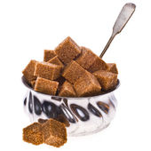 Brown cane sugar cubes in an old sugar bowl — Stock Photo