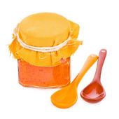 Glass jar with paprika sauce, ceramic spoons — Stock Photo