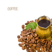 Bronze coffee maker and roasted coffee beans — Stock Photo