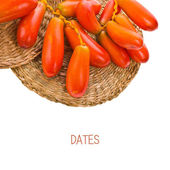 Fresh raw blonde dates on branches — Stock Photo