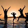 Silhouette of family jumping — Stock Photo