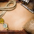 Compass rope and lamp on old paper — Stock Photo