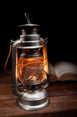 Old burning oil lamp — Stock Photo