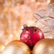 Gold and red christmas baubles — Stock Photo #27551375