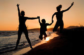 Family silhouette on the beach — Stock Photo