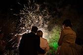 Admiring fireworks — Stock Photo