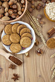 Cookies with Cocoa, Flour, Spices and Nuts on Wooden Background — Stock Photo