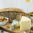 White Wine and cheese arrangement on the table — Stock Photo #39968431