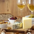 White Wine and cheese arrangement on the table — Stock Photo
