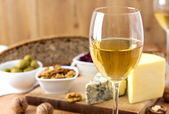 White Wine and cheese arrangement on the table — Stok fotoğraf