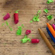 Stock Photo: Colorful crayons on wooden background