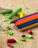 Colorful crayons on wooden table — Stok fotoğraf
