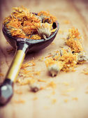 Dried Marigold Flowers in rustic spoon — Stock Photo