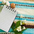 Note pad and white flower — Stock Photo #34617335