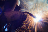 Welder steel structure in workshop — Stock Photo