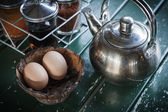 Teapot and egg in wooden cup — Stock Photo