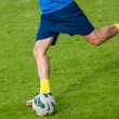 Football player kick the ball — Stock Photo