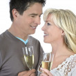 Mature couple celebrating with cocktails — Stock Photo