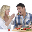 Happy mature couple having fun while cooking — Stock Photo