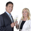 Male and female business celebrating with Champagne — Stock Photo