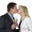 Man and woman kissing and celebrating with Champagne — Stock Photo