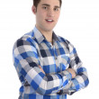 Young smilling man in blue shirt with crossed arms — Foto Stock
