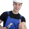 Young happy craftsman with pair of tongs, thum up — Stock Photo