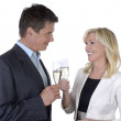 Male and female business celebrating with Champagne — Stock Photo #27569221