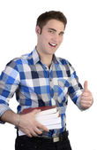 Young happy man in blue shirt with books, thumb up — Stock Photo