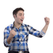 Young happy man in blue shirt cheering — Stock Photo
