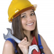 Pretty worker woman with spanner and hard hat — Stock Photo