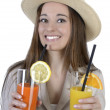 Pretty elegant woman with hat and two drinks — Stock Photo