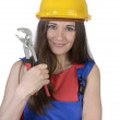 Pretty worker woman with pliers and hard hat — Stock Photo