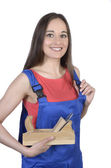 Pretty female worker with panner — Stock Photo