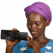 Pretty african girl smiling with video camera — Stock Photo #27628489