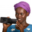 Pretty african girl smiling with video camera — Stock Photo