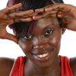 Pretty african girl smiling with hands on front — Stock Photo #27628795