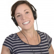 Young happy girl listens to music with headphones — Stock Photo #27686177
